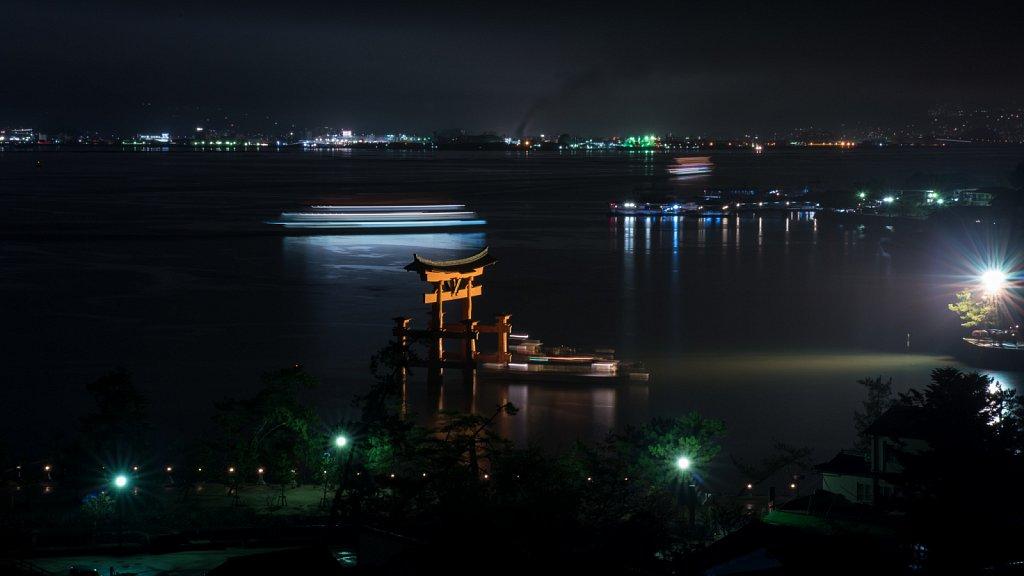 Long exposure of Miyajima Torii and party boat